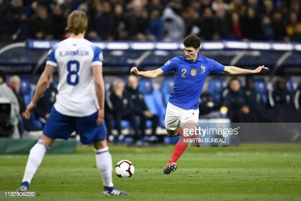 Iceland's midfielder Birkir Bjarnason and France's defender Benjamin Pavard vie for the ball during the UEFA Euro 2020 Group H qualification football...