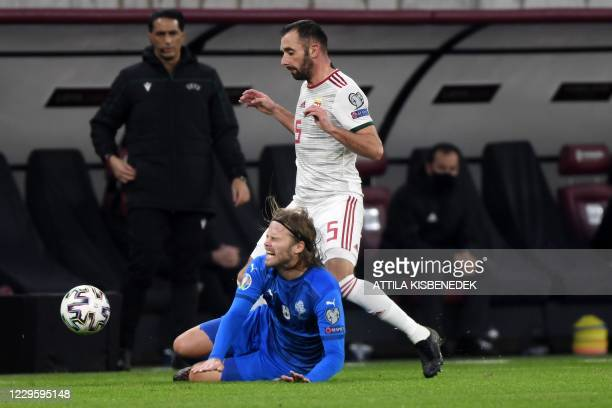 Iceland's midfielder Birkir Bjarnason and Hungary's defender Attila Fiola vie for the ball during the UEFA European Qualifiers play-off final...