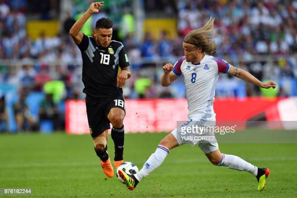 Iceland's midfielder Birkir Bjarnason challenges Argentina's midfielder Eduardo Salvio during the Russia 2018 World Cup Group D football match...