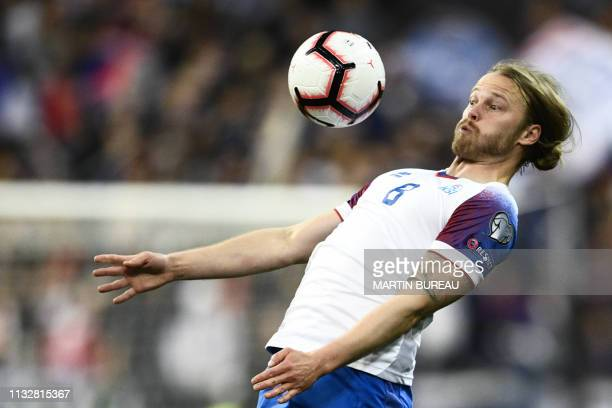 Iceland's midfielder Birkir Bjarnason eyes the ball during the UEFA Euro 2020 Group H qualification football match between France and Iceland at the...