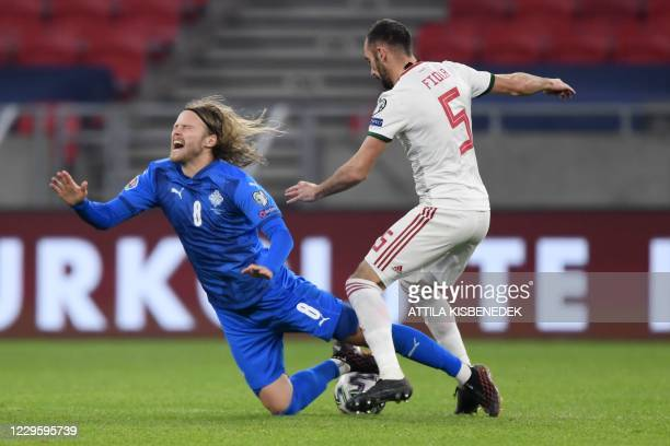 Iceland's midfielder Birkir Bjarnason is fouled by Hungary's defender Attila Fiola during the UEFA European Qualifiers play-off final football match...