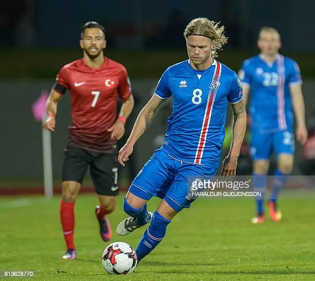 Iceland's midfielder Birkir Bjarnason plays the ball during the 2018 World Cup qualifier football match Iceland vs Turkey in Reykjavik Iceland on...