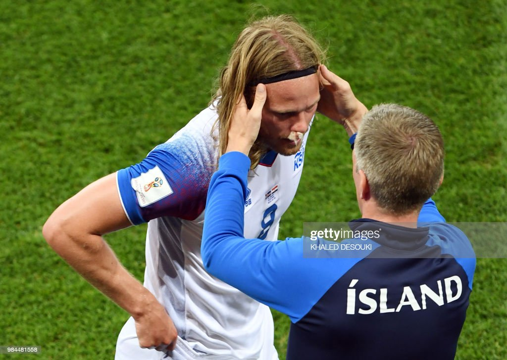 Iceland's midfielder Birkir Bjarnason receives medical attention after getting injured during the Russia 2018 World Cup Group D football match between Iceland and Croatia at the Rostov Arena in Rostov-On-Don on June 26, 2018. (Photo by Khaled DESOUKI / AFP) / RESTRICTED