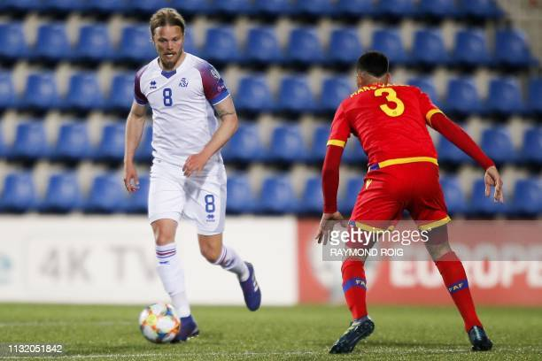 Iceland's midfielder Birkir Bjarnason vies with Andorra's midfielder Marc Vales the European football qualifiers football match between Andorra and...