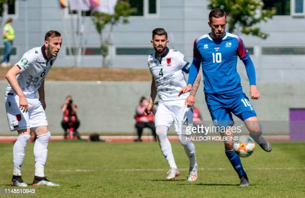 Iceland's midfielder Gylfi Sigurdsson and Albania's defender Ardian Ismajli vie for the ball during the UEFA Euro 2020 qualifier Group H football...