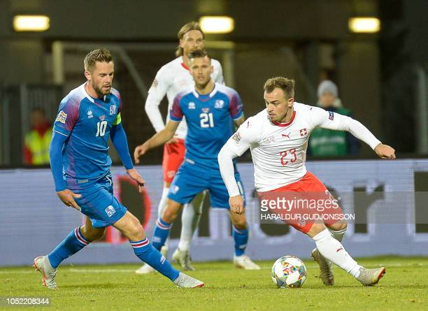 Iceland's midfielder Gylfi Sigurdsson and Switzerland's midfielder Xherdan Shaqiri vie for the ball during the UEFA Nations League Group Stage...