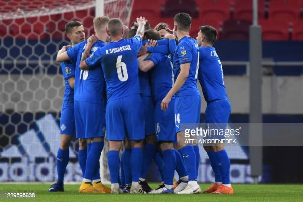 Iceland's midfielder Gylfi Sigurdsson celebrates after scoring a goal with teammates during the UEFA European Qualifiers play-off final football...