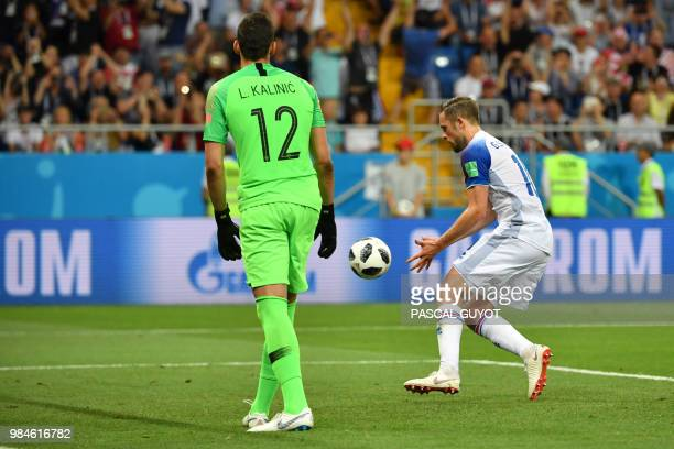 Iceland's midfielder Gylfi Sigurdsson celebrates after scoring a goal during the Russia 2018 World Cup Group D football match between Iceland and...