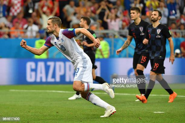 TOPSHOT Iceland's midfielder Gylfi Sigurdsson celebrates after scoring a goal during the Russia 2018 World Cup Group D football match between Iceland...