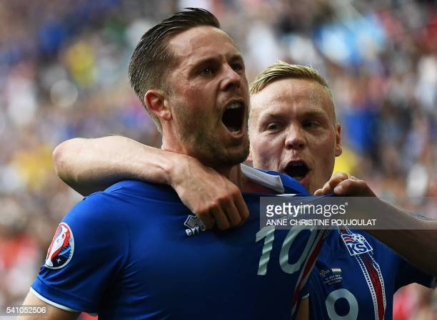 TOPSHOT Iceland's midfielder Gylfi Sigurdsson celebrates after scoring his team's first goal during the Euro 2016 group F football match between...