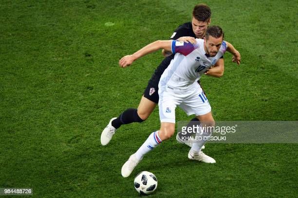 Iceland's midfielder Gylfi Sigurdsson challenges Croatia's defender Duje Caleta Car during the Russia 2018 World Cup Group D football match between...