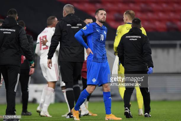 Iceland's midfielder Gylfi Sigurdsson looks on after the UEFA European Qualifiers play-off final football match between Hungary and Iceland at the...