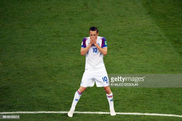 Iceland's midfielder Gylfi Sigurdsson reacts during the Russia 2018 World Cup Group D football match between Iceland and Croatia at the Rostov Arena...