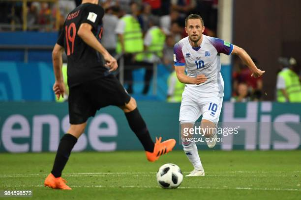 Iceland's midfielder Gylfi Sigurdsson runs toward the ball during the Russia 2018 World Cup Group D football match between Iceland and Croatia at the...