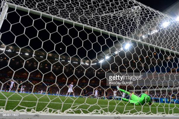 Iceland's midfielder Gylfi Sigurdsson scores a penalty kick during the Russia 2018 World Cup Group D football match between Iceland and Croatia at...