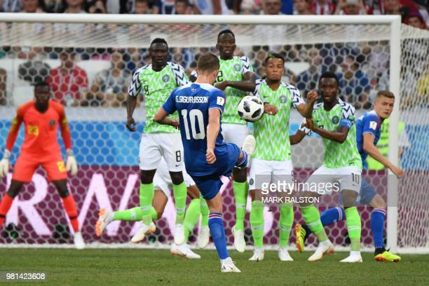 Iceland's midfielder Gylfi Sigurdsson takes a freekick during the Russia 2018 World Cup Group D football match between Nigeria and Iceland at the...