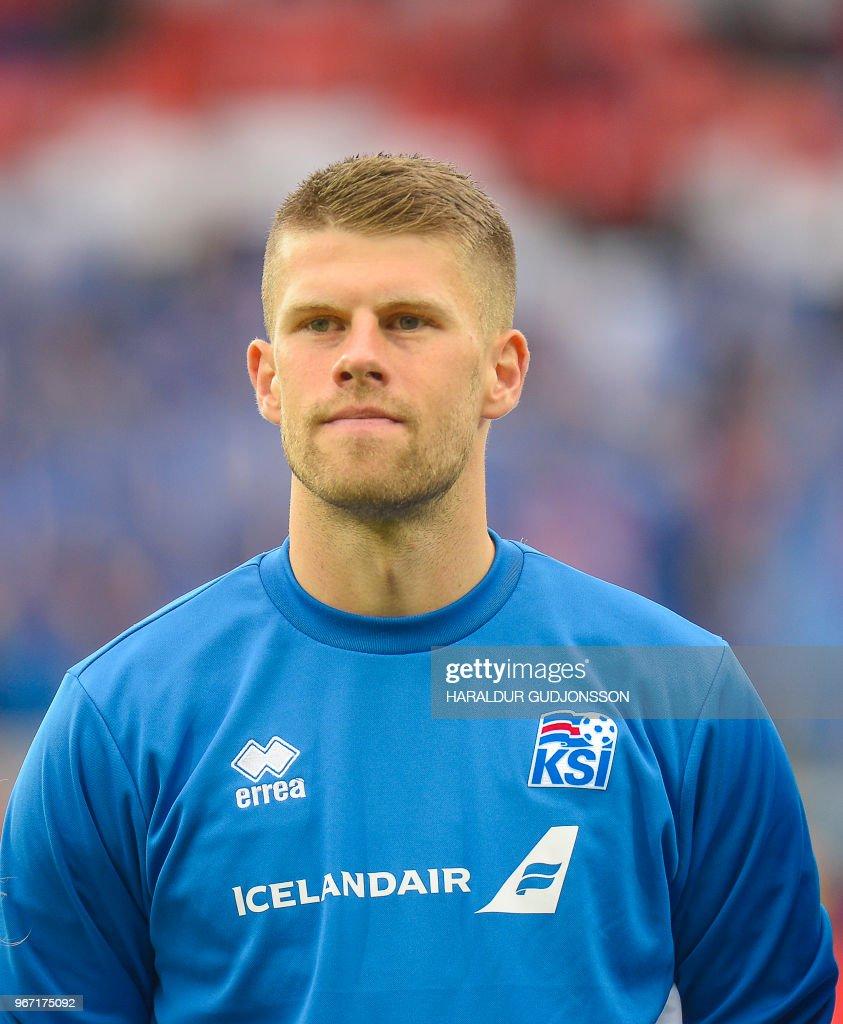 Iceland's midfielder Johann Berg Gudmundsson lines up prior to the international friendly football match Iceland v Norway in Reykjavik, Iceland on June 2, 2018.