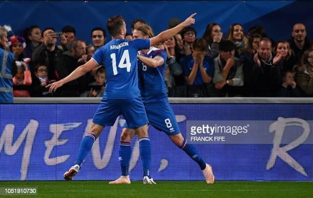 Iceland's midfielder Kari Arnason celebrates his goal with his teammate Iceland's midfielder Birkir Bjarnason during the friendly football match...