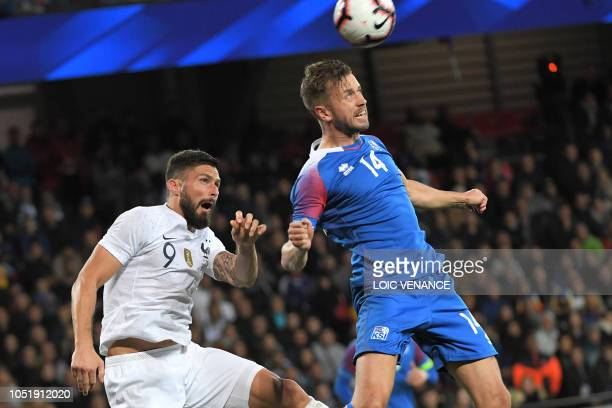 Iceland's midfielder Kari Arnason vies with France's forward Olivier Giroud during the friendly football match between France and Iceland at the...