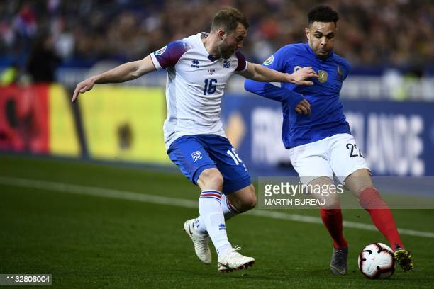 Iceland's midfielder Runar Mar Sigurjonsson and France's defender Layvin Kurzawa vie for the ball during the UEFA Euro 2020 Group H qualification...