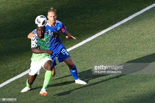 TOPSHOT Iceland's midfielder Rurik Gislason challenges Nigeria's midfielder Oghenekaro Etebo during the Russia 2018 World Cup Group D football match...
