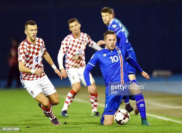 Iceland's midfiielder Gylfi Sigurdsson vies with Croatia's midfielder Ivan Perisic during the 2018 World Cup football qualification match between...