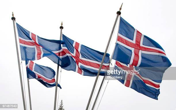 Iceland's national flag flies from flagpoles outside a polling station in Reykjavik Iceland on Saturday March 6 2010 Icelanders are voting in a...
