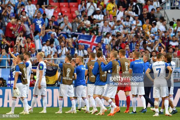 Iceland's players acknowledge fans at the end of the Russia 2018 World Cup Group D football match between Argentina and Iceland at the Spartak...
