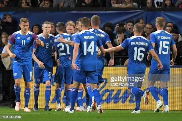 Iceland's players celebrate after scoring a goal during the friendly football match between France and Iceland at the Roudourou Stadium in Guingamp...
