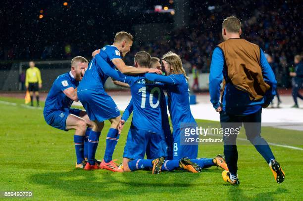 Iceland's players celebrates scoring during the FIFA World Cup 2018 qualification football match between Iceland and Kosovo in Reykjavik Iceland on...