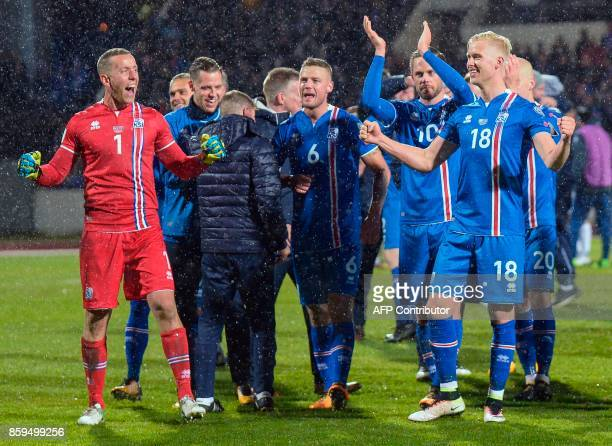 Iceland's players including goalkeeper Hannes Thor Halldorsson and Iceland's Hordur Magnusson celebrate after the FIFA World Cup 2018 qualification...