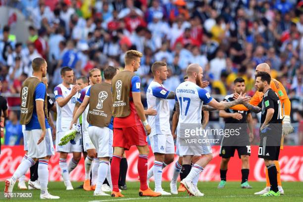 Iceland's players shake hands with Argentina's forward Lionel Messi at the end of the Russia 2018 World Cup Group D football match between Argentina...