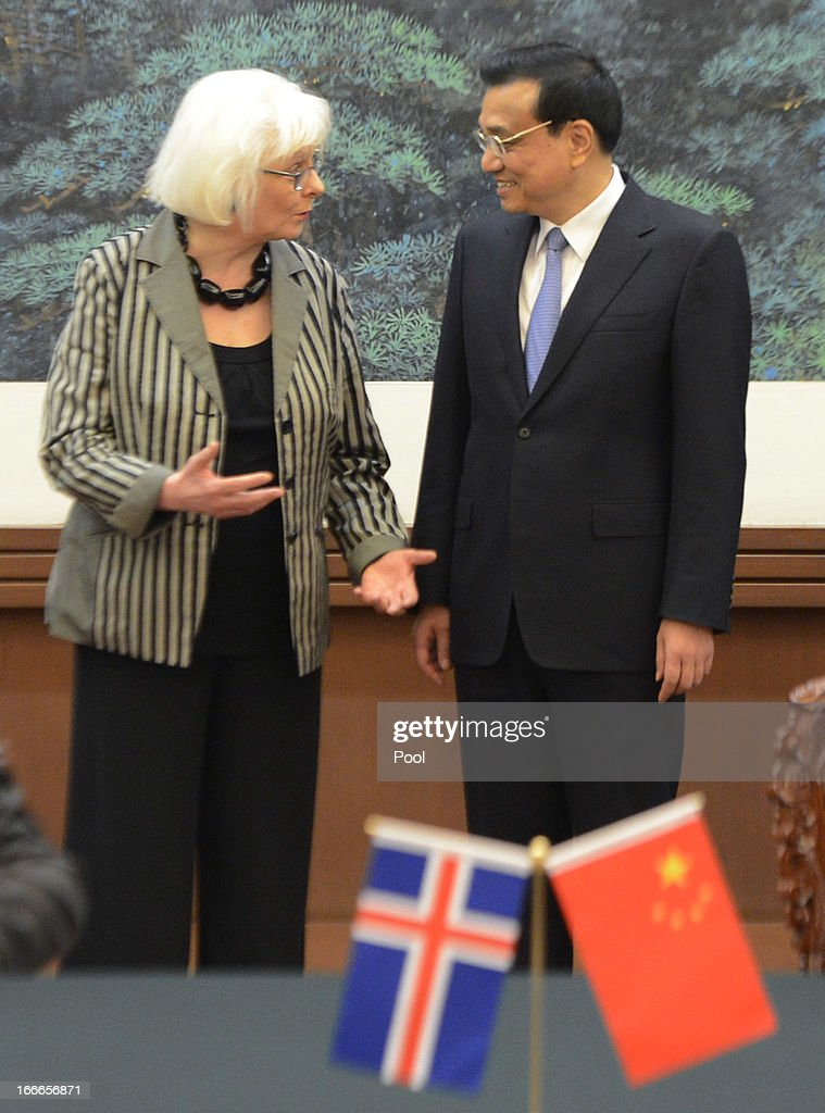 Iceland's Prime Minister Johanna Sigurdardottir (L) and Chinese Premier Li Keqiang attend a signing ceremony at the Great Hall of the People on April 15, 2013 in Beijing, China. During her five day official visit to China, Prime Minister of Iceland Johanna Sigurdardottir is holding talks with China's Premier Li Keqiang concerning bilateral trade relations and a free trade agreement.