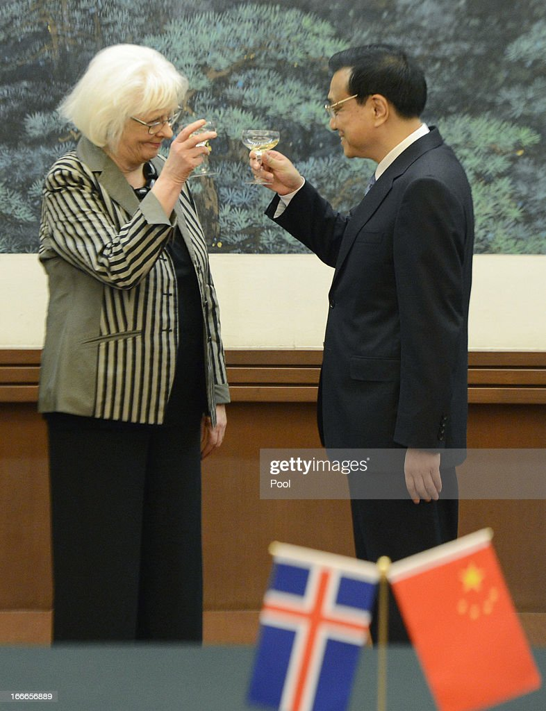 Iceland's Prime Minister Johanna Sigurdardottir (L) and Chinese Premier Li Keqiang raise a toast during a signing ceremony at the Great Hall of the People on April 15, 2013 in Beijing, China. During her five day official visit to China, Prime Minister of Iceland Johanna Sigurdardottir is holding talks with China's Premier Li Keqiang concerning bilateral trade relations and a free trade agreement.