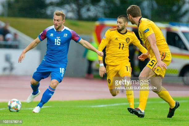 Iceland's Runar Mar Sigurjonsson and Belgium's Yannick Carrasco vie for the ball during the Nations League football match between Iceland and Belgium...