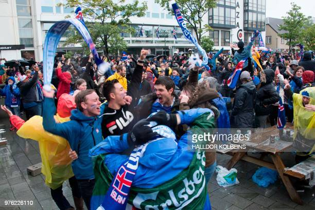 Iceland's supporters celebrate the results of Iceland national football team's first match against Argentina in the Russia 2018 World Cup in...