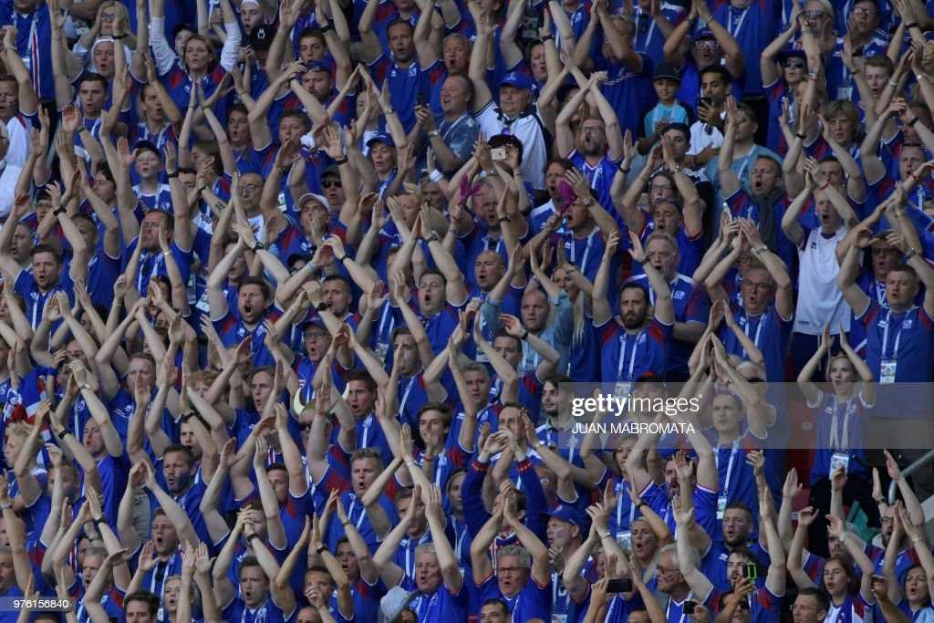TOPSHOT - Iceland's supporters cheer their team during the Russia 2018 World Cup Group D football match between Argentina and Iceland at the Spartak Stadium in Moscow on June 16, 2018. (Photo by Juan Mabromata / AFP) / RESTRICTED