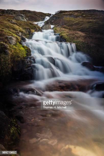 iceland-westfjords-hesteyri-thvera falls - brook mitchell foto e immagini stock