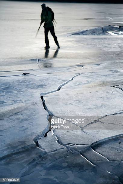 iceskater on lake in dalsland - dalsland stock photos and pictures