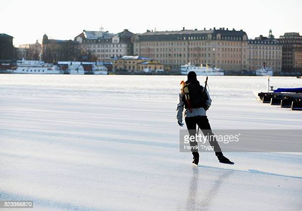iceskater on nybroviken - ice skate stock pictures, royalty-free photos & images