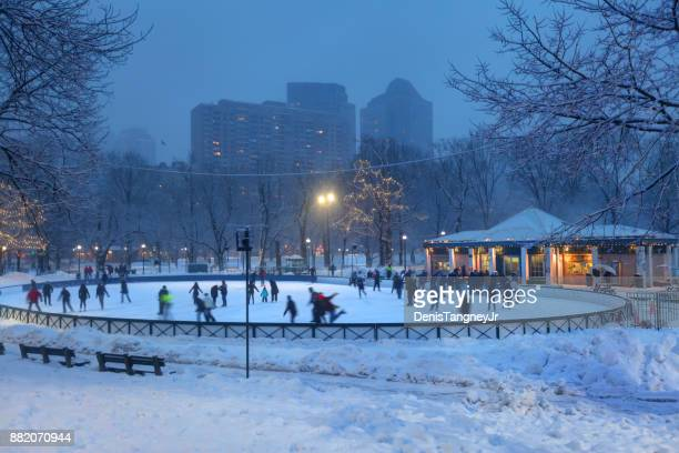 ice-skating on frog pond in the boston common - boston common stock pictures, royalty-free photos & images