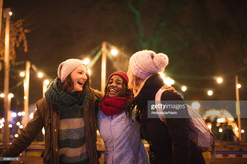 Ice-skating with friends : Stock Photo