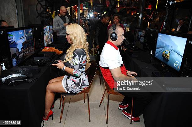 Ice-T and Coco get hands on with Sunset Overdrive at the XboxOne Loft on October 27, 2014 in New York City.
