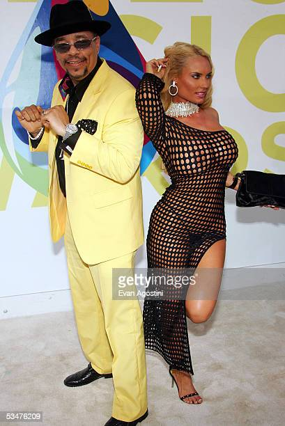 IceT and wife Coco arrive at the 2005 MTV Video Music Awards at the American Airlines Arena on August 28 2005 in Miami Florida