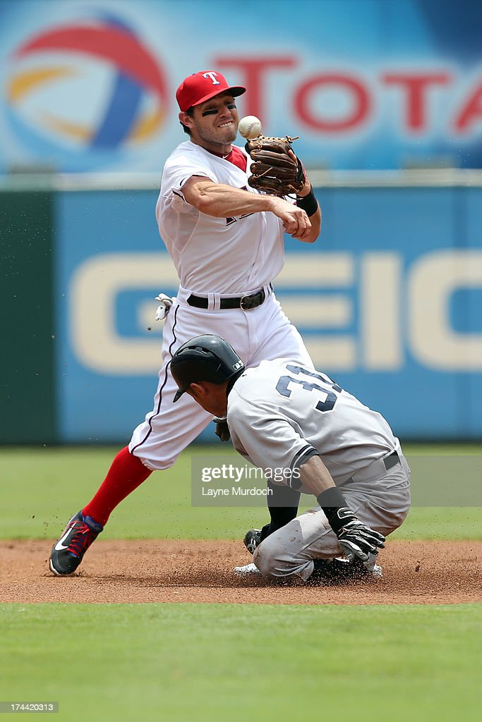 Icharo Suzuki #31 of the New York Yankees is forced out at second base but breaks up the double play attempt by Ian Kinsler #5 of the Texas Rangers on July 25, 2013 at the Rangers Ballpark in Arlington in Arlington, Texas.