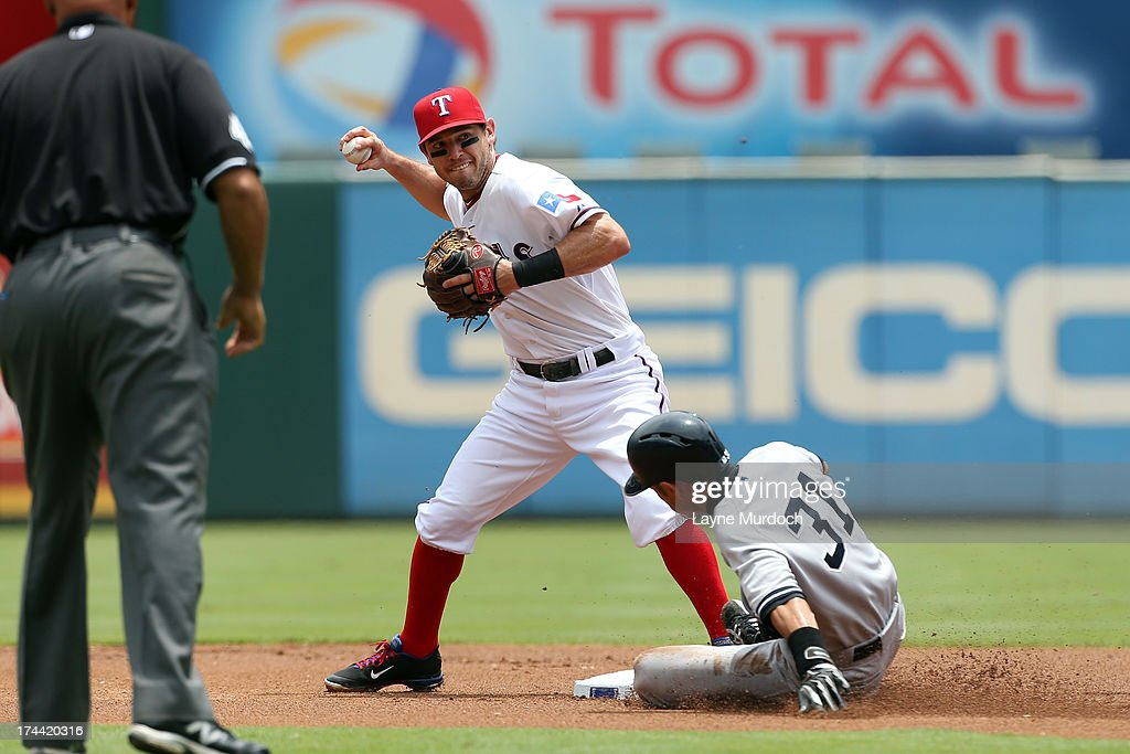 Icharo Suzuki #31 of the New York Yankees is forced out at second base but breaks up the double play attempt by Ian Kinsler #5, second baseman of the Texas Rangers on July 25, 2013 at the Rangers Ballpark in Arlington in Arlington, Texas.