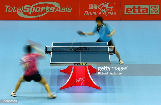 Ching Cheng of Chinese Taipei and Wing Nam Ng of Hong Kong in action in a preliminary group match during the ITTF Pro Tour Table Tennis Grand Finals...