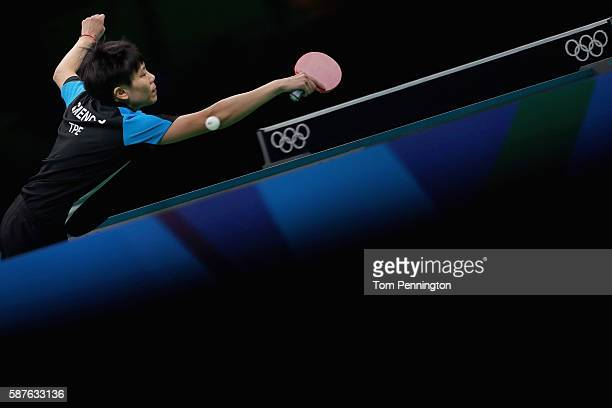 Ching Cheng of Chinese Taipei competes against Xiaoxia Li of China during the Women's Singles Quarterfinal 3 Table Tennis on Day 4 of the Rio 2016...