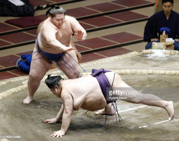 Ichinojo sends Akiseyama to his first loss on the seventh day of the New Year Grand Sumo Tournament at Ryogoku Kokugikan in Tokyo on Jan. 16, 2021.