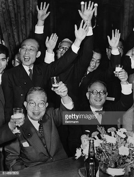 Ichiro Hatoyama newly-elected Japanese Premier, and Mamoru Shigemitsu , one time war criminal, raise glasses in a toast while Democratic Party...